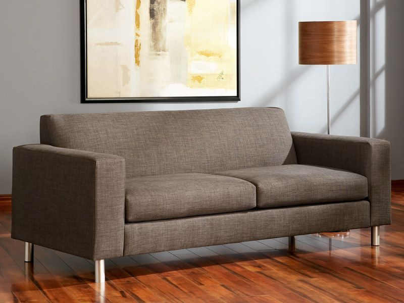 The versatile charcoal color of the Pia Sofa lets you design a modern monochromatic setting or becomes the backdrop to colorful accents.