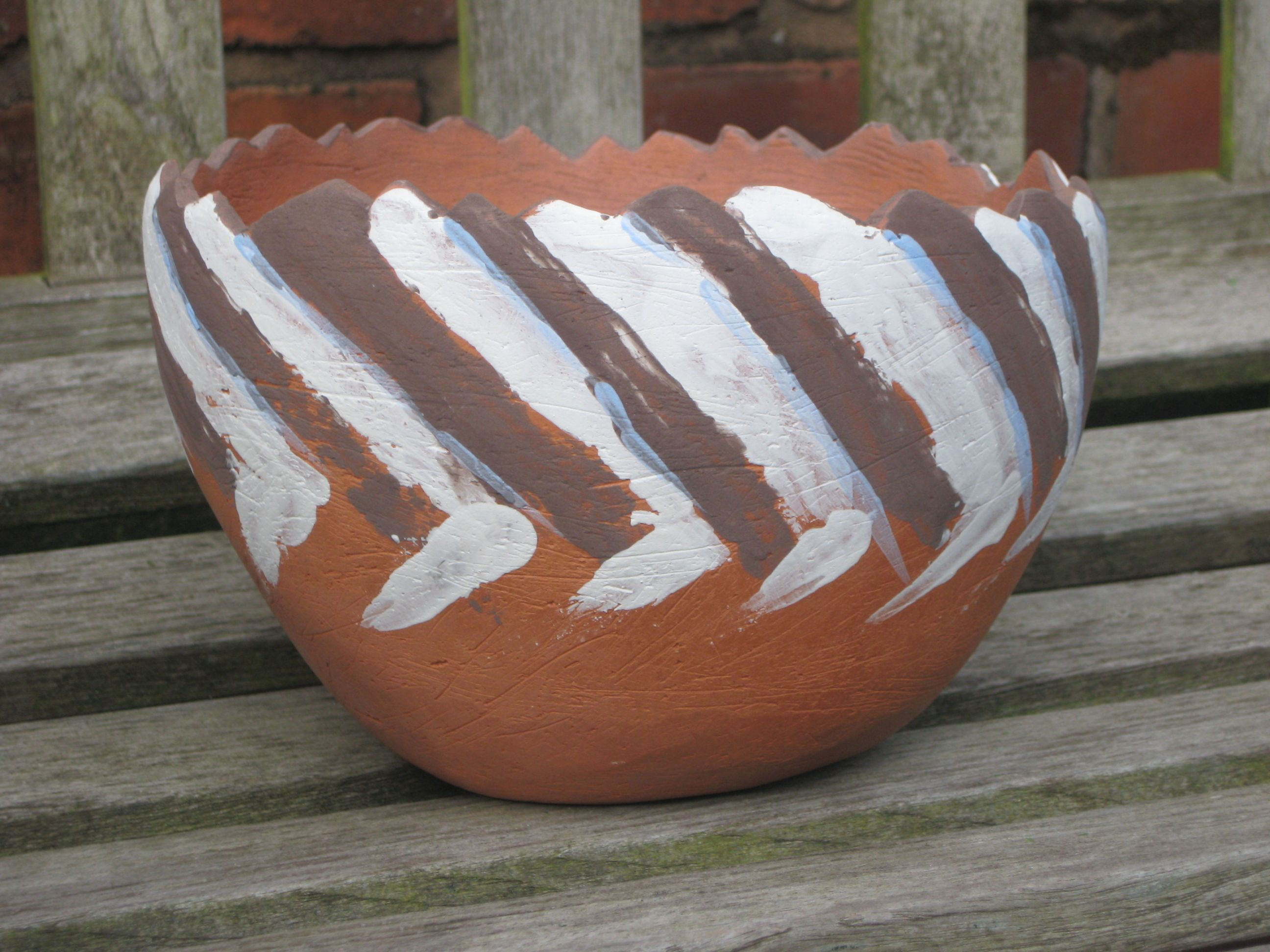 Terracotta bowl decorated with underglaze colour applied with palette knife