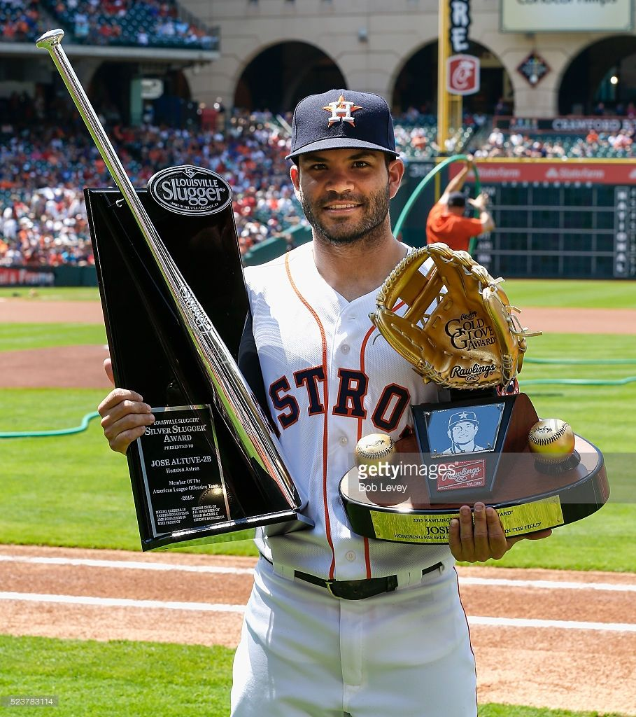 Jose Altuve, HOU, is presented with his Gold Glove and ...