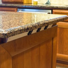 power strip under the countertop on island like this better than putting the outlet directly - Kitchen Island Outlet Ideas