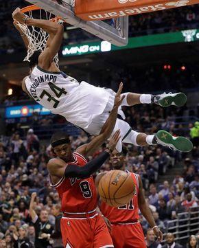 Milwaukee Bucks Giannis Antetokounmpo Dunks Over Chicago Bulls Rajon Rondo And Jimmy Butler During Mor Milwaukee Bucks Nba Basketball Art Nba Best Dunks