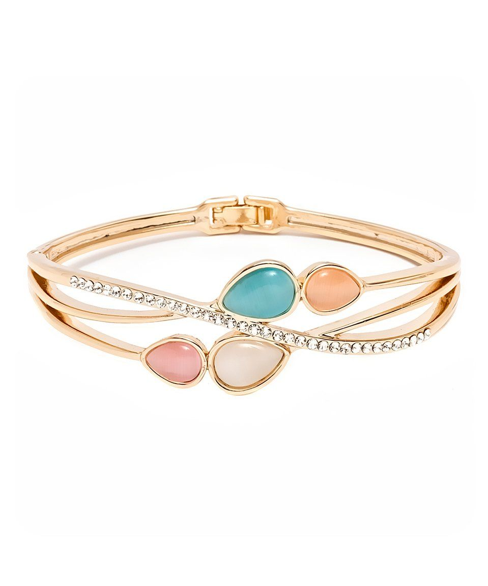 Take a look at this rose gold crisscross teardrop bangle with