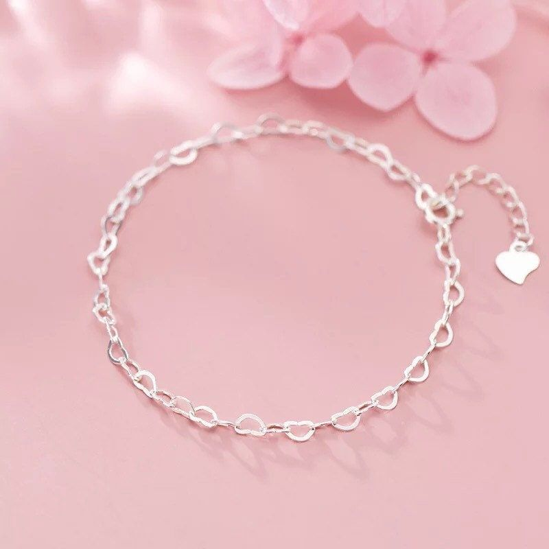 Handmade heart bracelet made with sterling silver . All material used is recycled sterling silver Lenght: 16CM+ 3CM Item will arrive in a beautiful box beautifully wrapped and ready for gift giving I can personalise the box for you without any extra charge