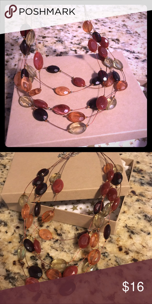 Beautiful autumn colors cascading necklace Just in time for fall, this beautiful cascading necklace has fall colors with beads of tan, brown, orange and light green. Feel free to make me an offer! Thanks for stopping by! Handmade Jewelry Necklaces