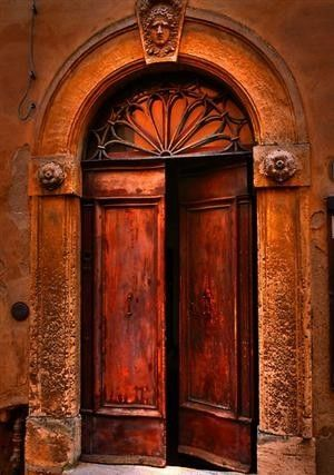 \ Behind Closed Doors\  by Luke Griffin Volterra Tuscany Italy I like the fan window above the door. & Color rojo (cálido) en puerta (Ciudad) Red color (Warm) at the ...