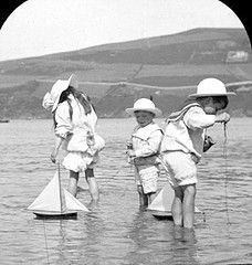 Girls and boys with model sailboats