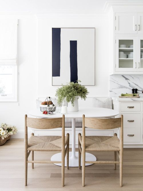 A Modern White Oval Dining Table Is Paired With Rush Seat Dining Prepossessing White Oval Dining Room Table Review