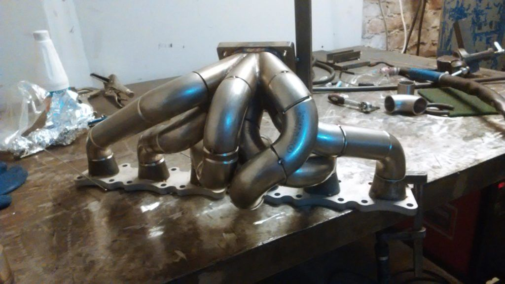 custom turbo exhaust headers for a Mercedes M104 | W124