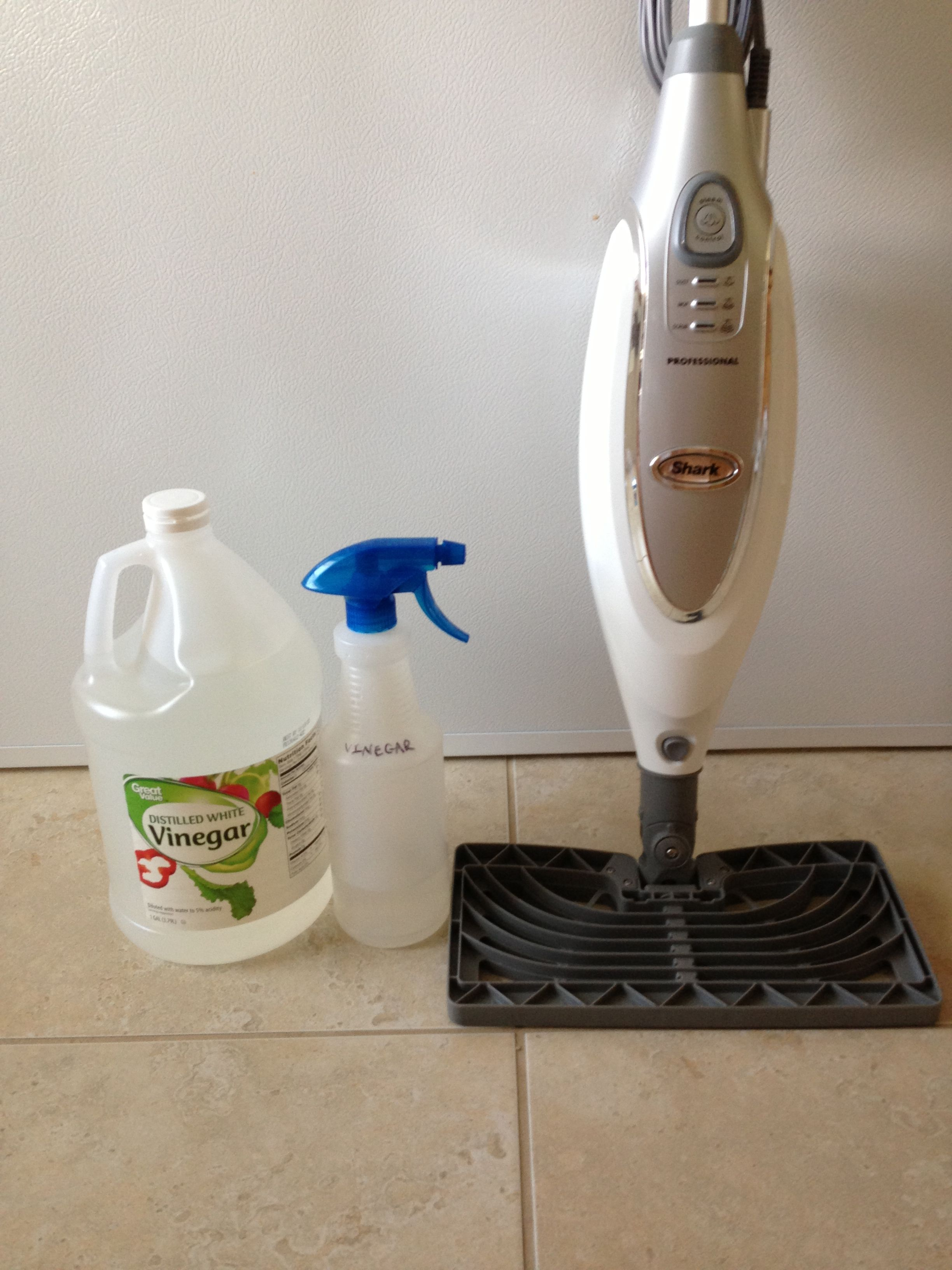 Use Spray Bottle To Mist Vinegar On Your Tile Then Run
