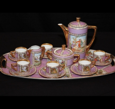 Delicate French antique pink and gold tea service.