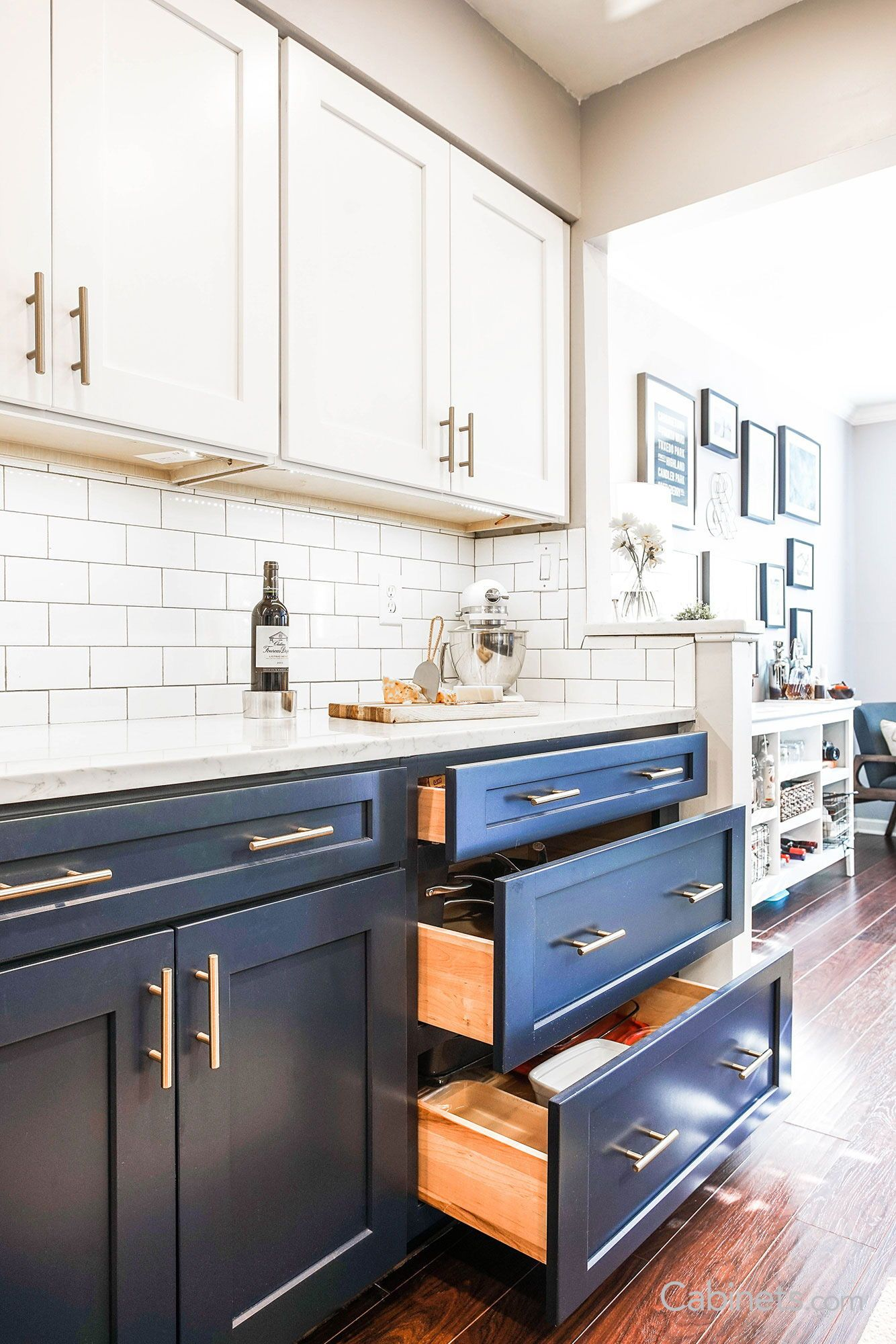 Classic Kitchen With Navy And White Cabinets White Subway And Wood Flooring White Kitchen Design White Shaker Kitchen Navy Kitchen Cabinets