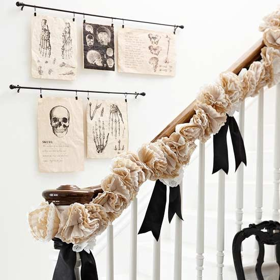 Ghostly Staircase & Wall Hangings~  Suspend ghoulish artwork from curtain rods that were enlarged medical textbook clip-art images. The embellish railings with garlands are crafted from layered 4 & 8-inch doilies and coffee filters. The black ribbon added to the garland is also adds. I would probably add some black plastic spiders on the garland too~