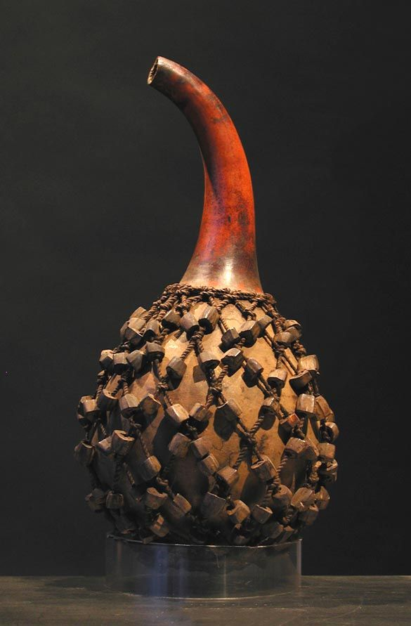 Bamilke musical instrument. Calabash, fiber and tree nuts