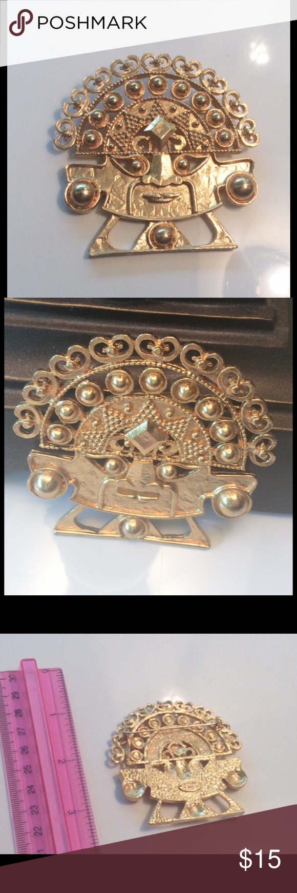 Large Aztec Face Brooch New Vintage Vintage, stored never worn. Terrific gold tone detail. Signed, with @ copyright mark, Maxine Denker Jewelry Brooches
