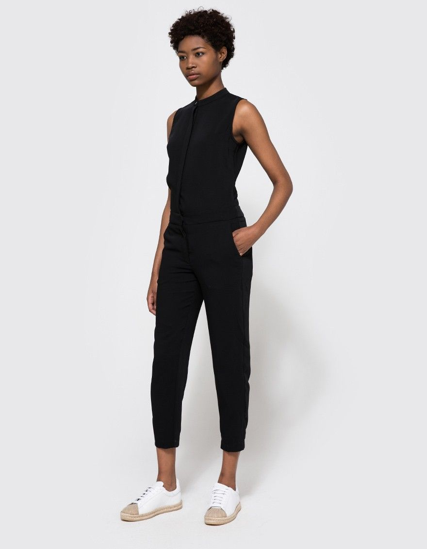 From Won Hundred, a fitted jumpsuit in Black. Features slim band collar, concealed full-button placket, darts at bust, hook-and-bar closure at waist, two-button fly, back cut out, slanted front pockets, back welt pockets, tapered leg and a classic fit.
