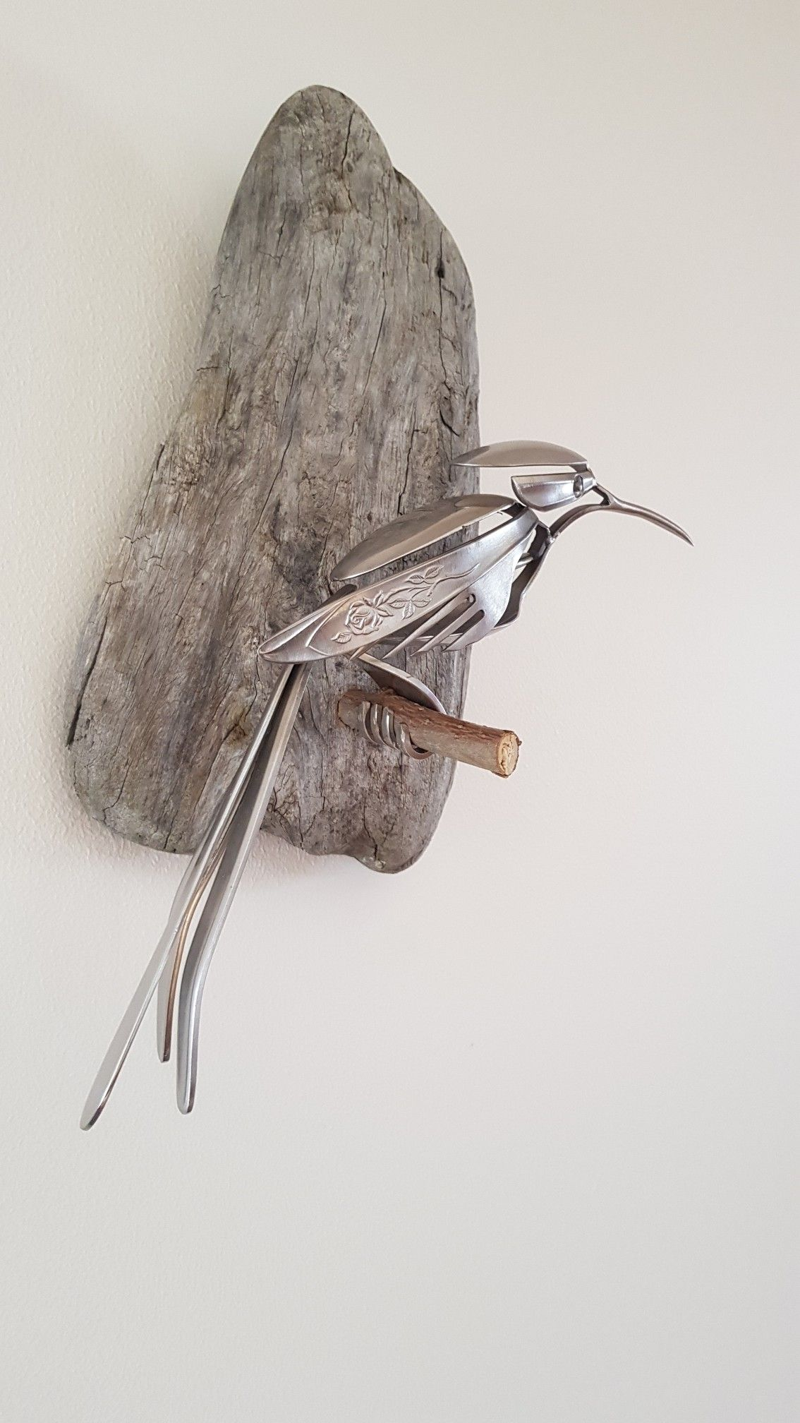 Bird made from recycled stainless steel spoons and forks