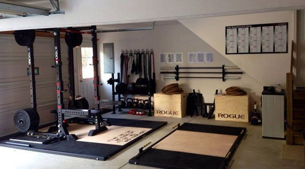 Rogue fitness themed super strength training home gym with