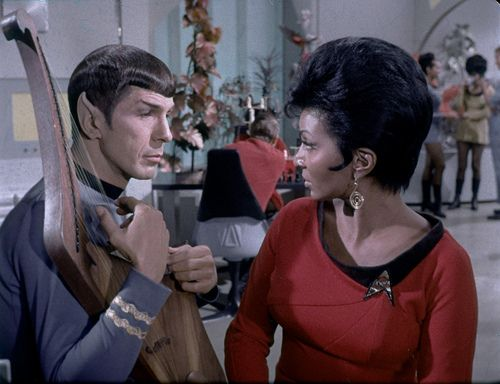 Star Trek, the original Spock and Uhura. Yeah, they always had a thing for each other! ;)