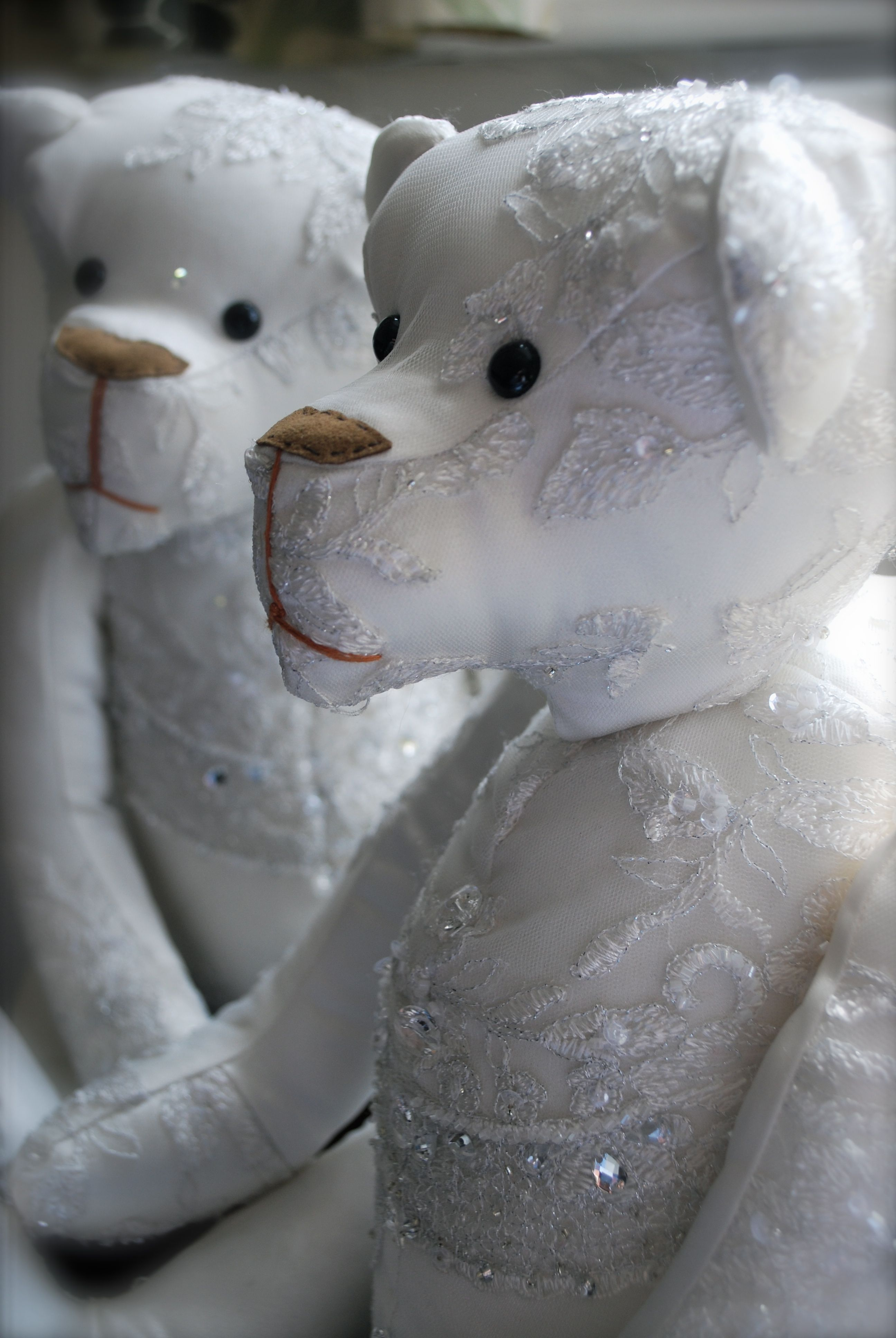 two bears made from one lovely wedding dress. www.bowmanbears