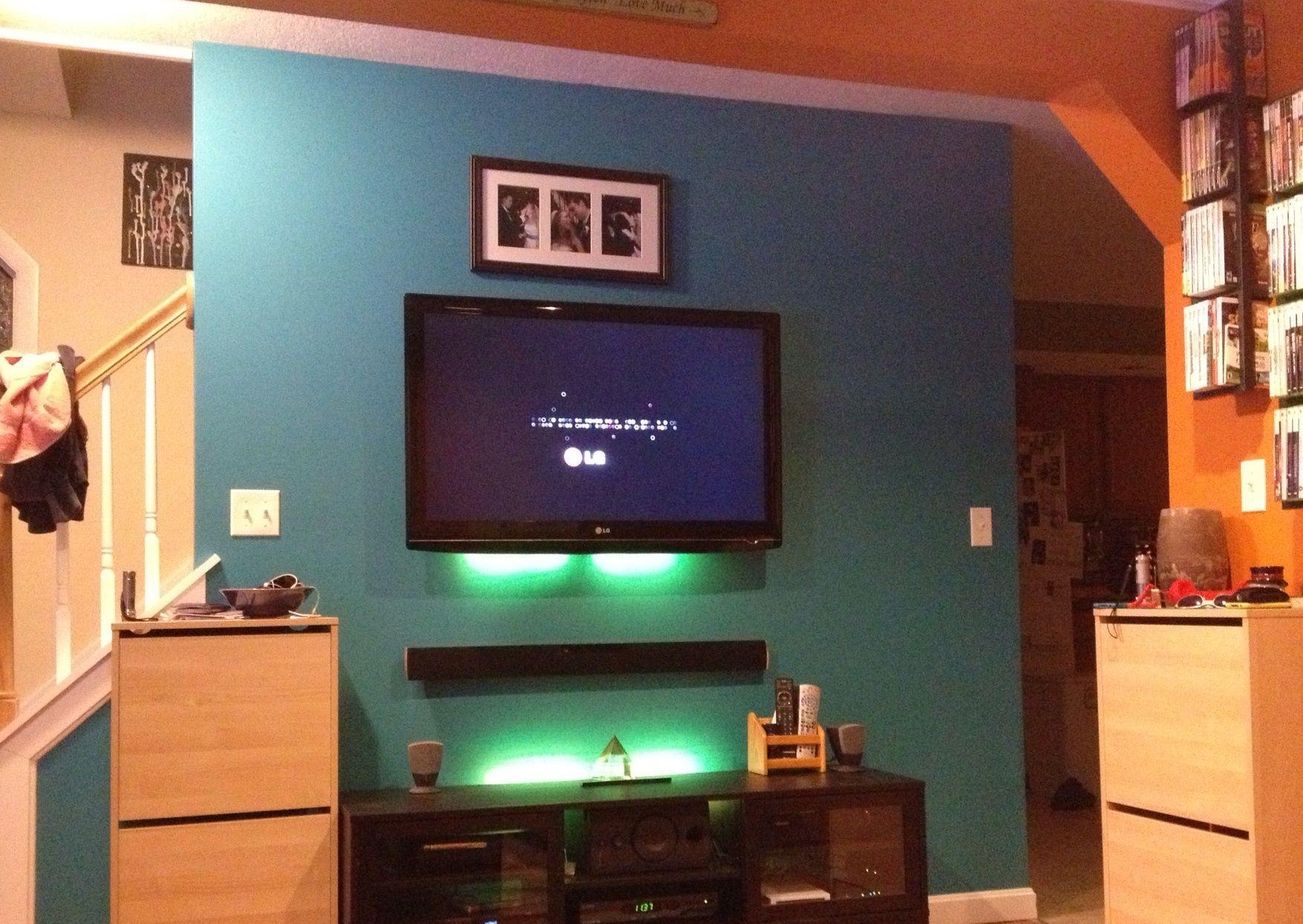 Hang tv and sound bar use stand for deco living room pinterest tv walls living rooms for Best soundbar for large living room