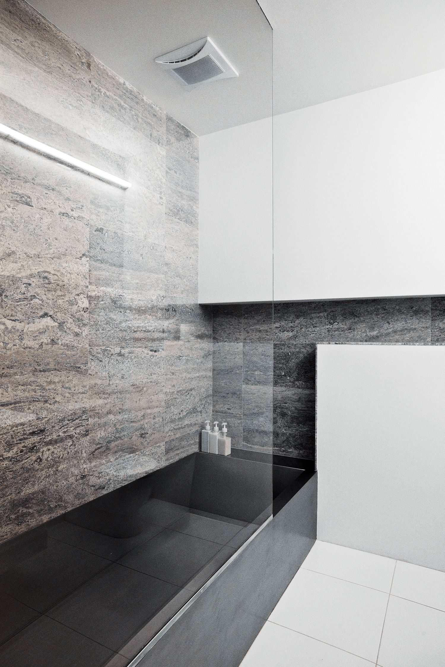 stainless steel tub travertine wall