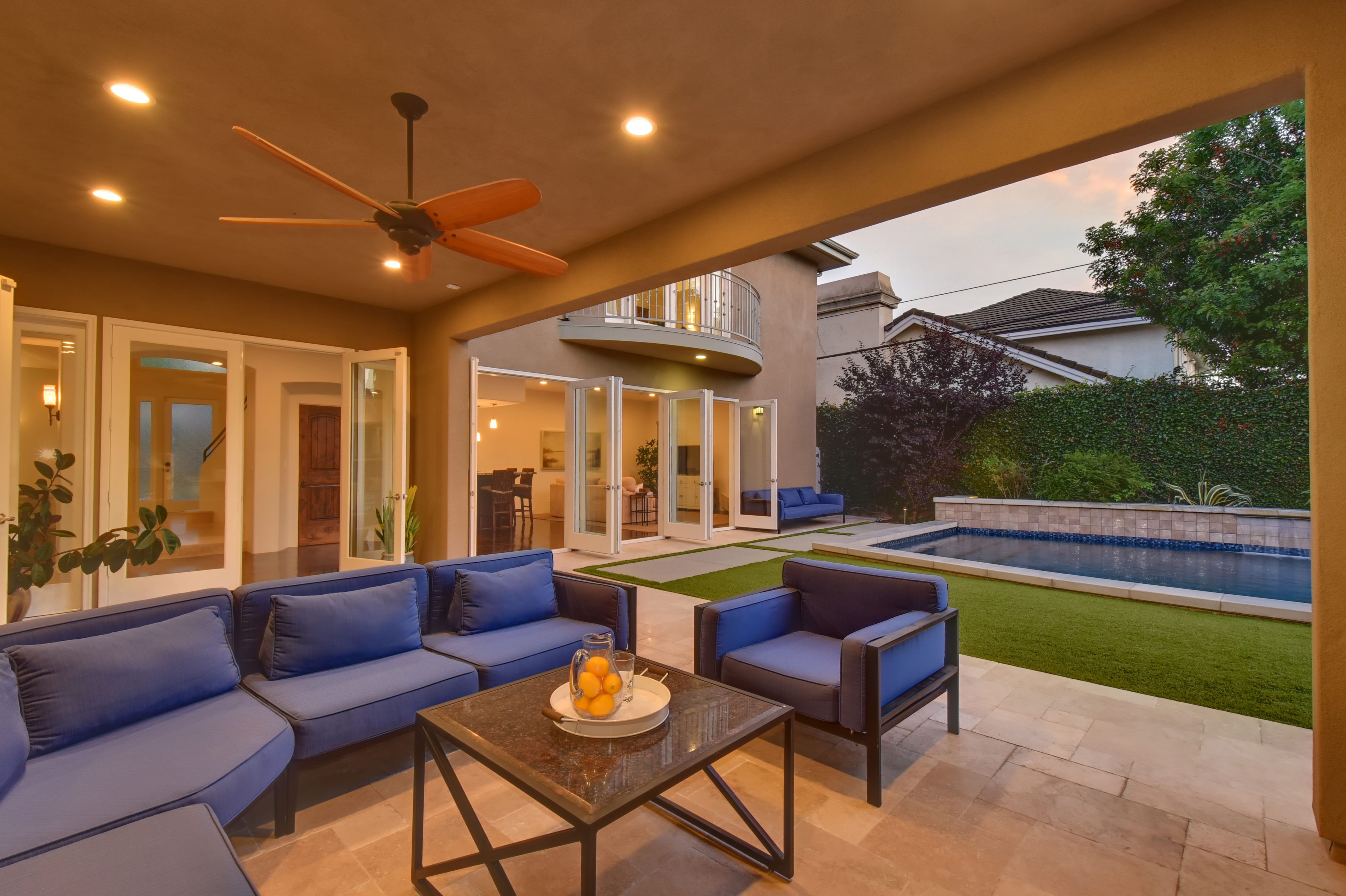 Serene Backyard Features a Covered Outdoor Living Space ... on Ab Outdoor Living id=52532