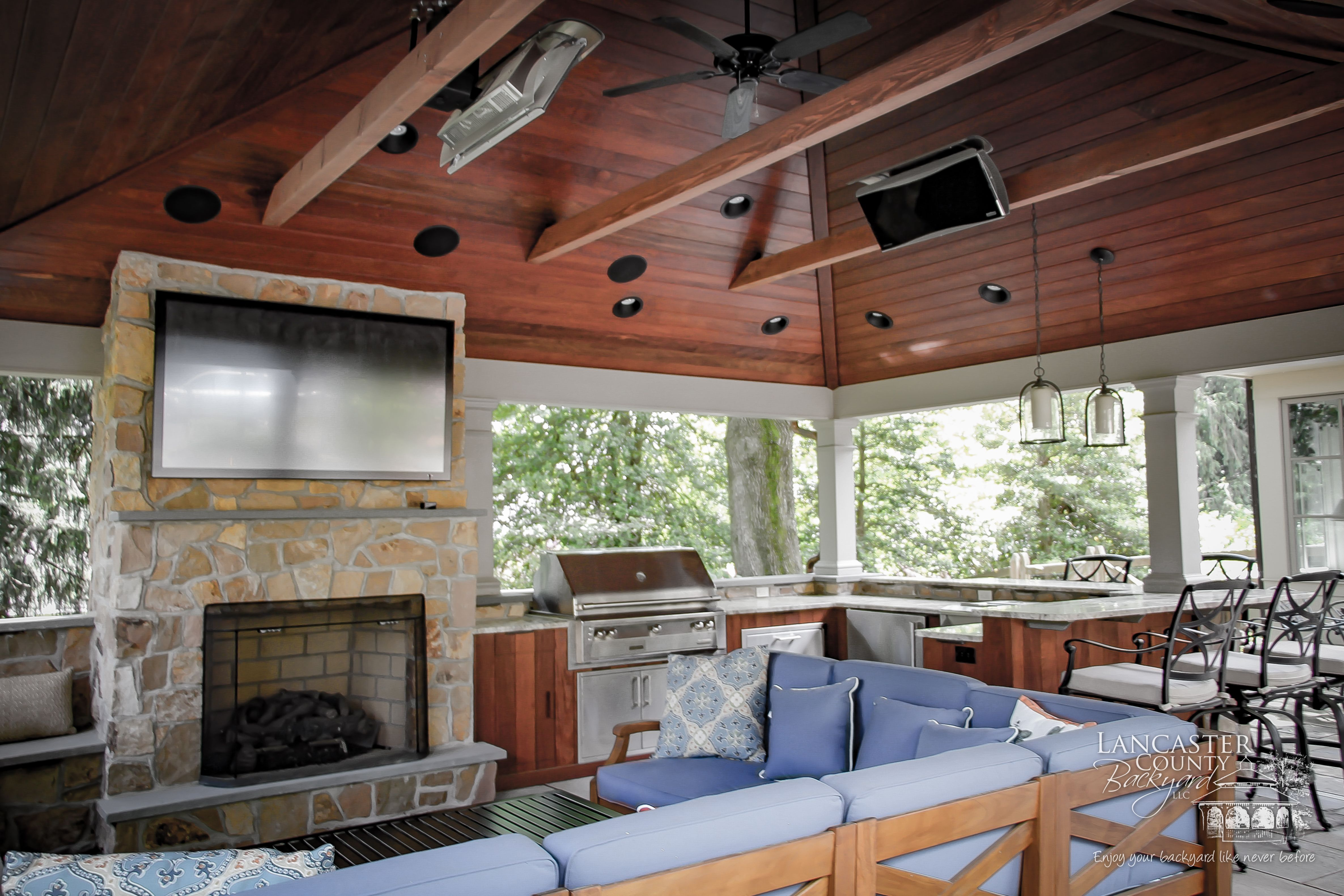 Fireplace, Kitchen, and Entertainment in High End Backyard Pavilion