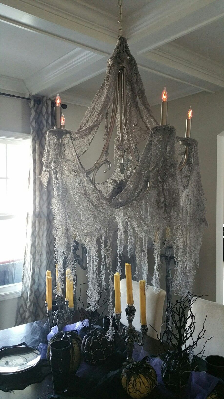 gray creepy cloth and flickering light bulbs | evil soul studios in