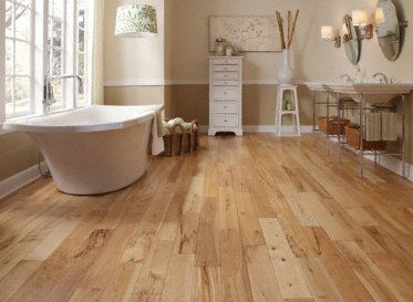 A beautiful light handscraped wood for a casual yet high for High end hardwood flooring