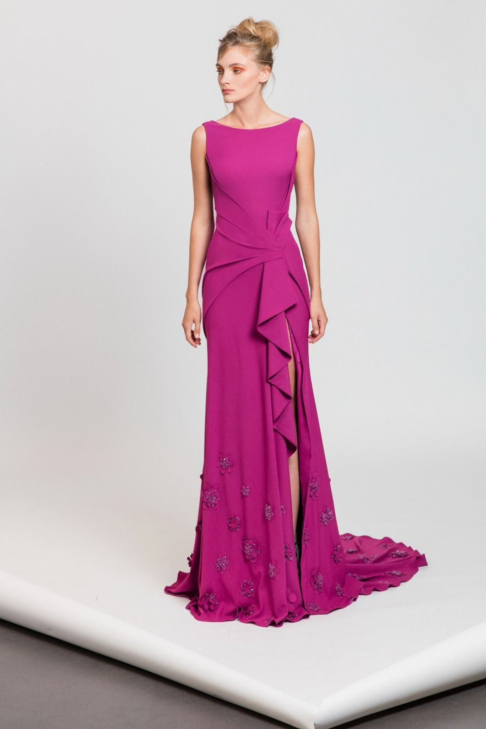 Magenta moroccan crepe dress with bateau neckline featuring a side