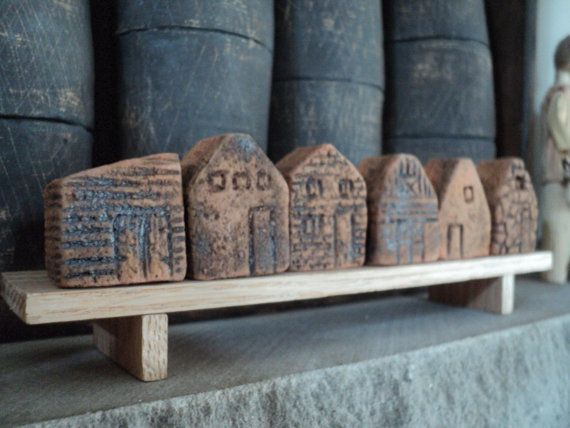 Tiny Clay Houses on a Bench by Ellen Jamiolkowski