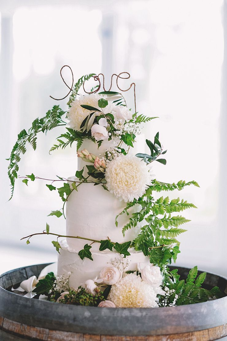 Whimsical botanical wedding cake with wire 'Love' topper | Popcorn Photography