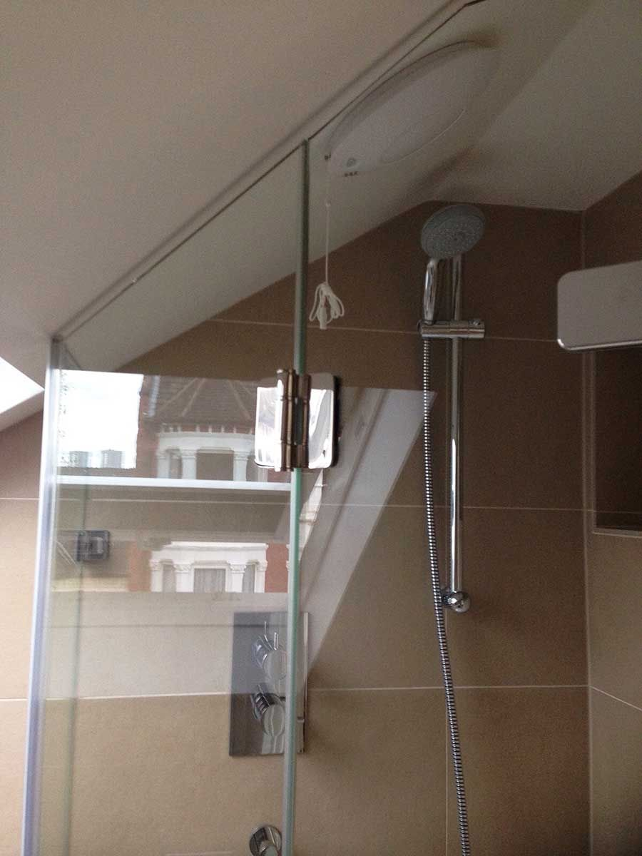 This angled frameless shower enclosure was created by Room H2o for a ...