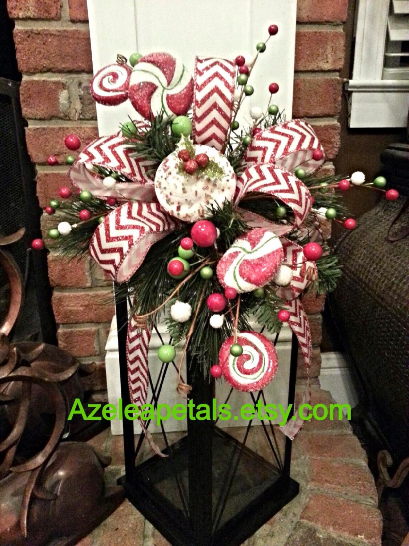 Christmas candy lantern swag, Tree Topper, christmas red and white lantern swag, candle decor, christmas candle, Christmas arrangement by Azeleapetals on Etsy https://www.etsy.com/listing/166491048/christmas-candy-lantern-swag-tree-topper