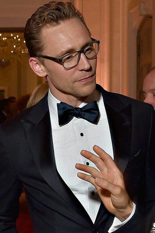 Tux and glasses. Deadly combo.  (Tom Hiddlestone)  http://maryxglz.tumblr.com/post/152867528272/maneth985-tux-and-glasses-have-mercy-deadly