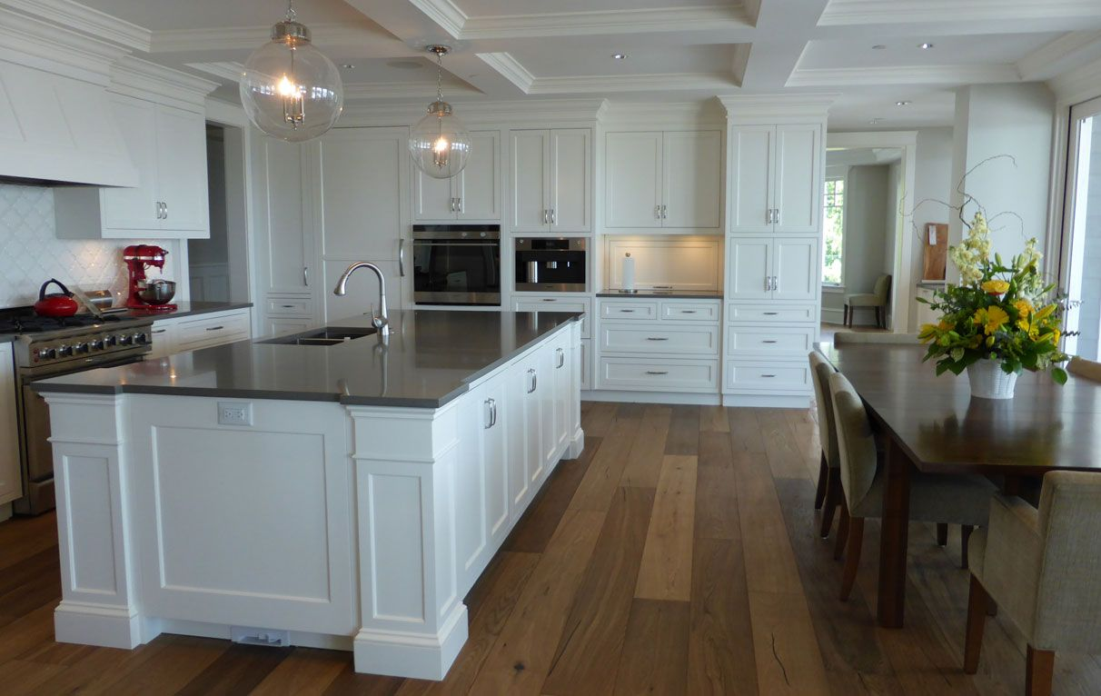 This custom classic white kitchen with beaded inset face ...