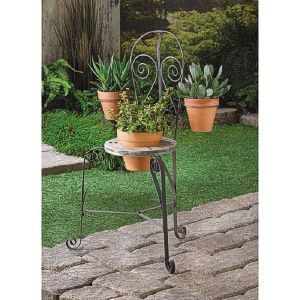 """Pull up a chair and grow a while! This engaging planter looks like an outdoor seat at a bustling French cafe, complete with decorative curled metal accents. It holds three potted plants and will make your visitors say, """"Ooh la la!"""" http://www.wholesalemart.com/Wholesale-Garden-Planters-s/159.htm"""