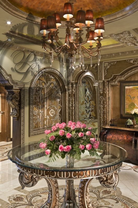 Foyer Interior Vision : Roses on foyer table welcome guests with a beautiful view
