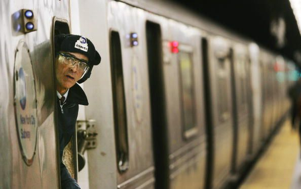 A Train Conductor Peers Out Of A New York City Subway Car December Train Conductor New York City Conductors