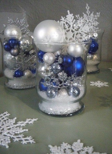 Fake snow, ornaments and a snowflake to top it all of. Perfect!
