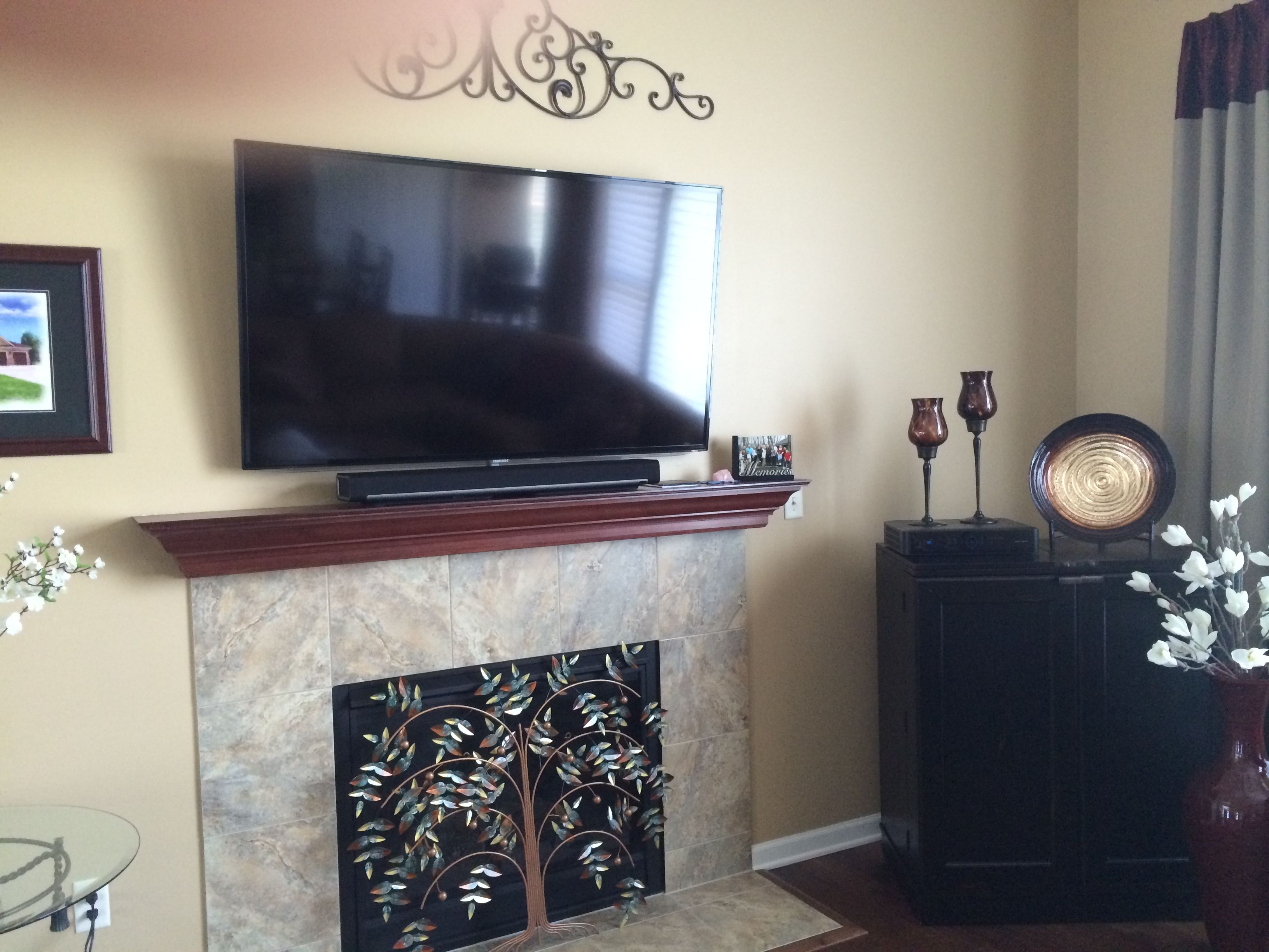 Flat Panel Tv Mounted Over A Fireplace With Sonos Soundbar Model