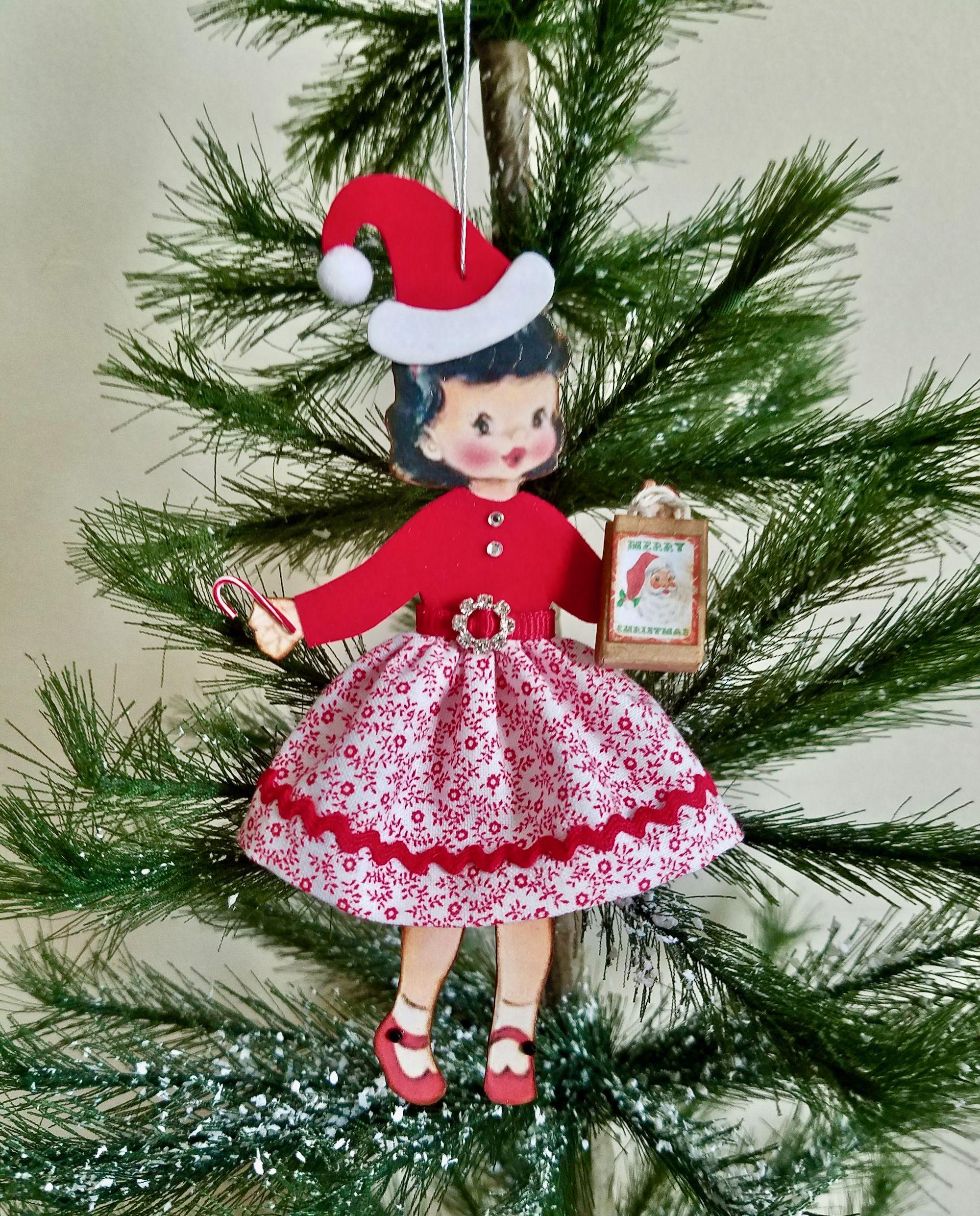 Handmade retro '50's paper doll ornament wearing a Santa