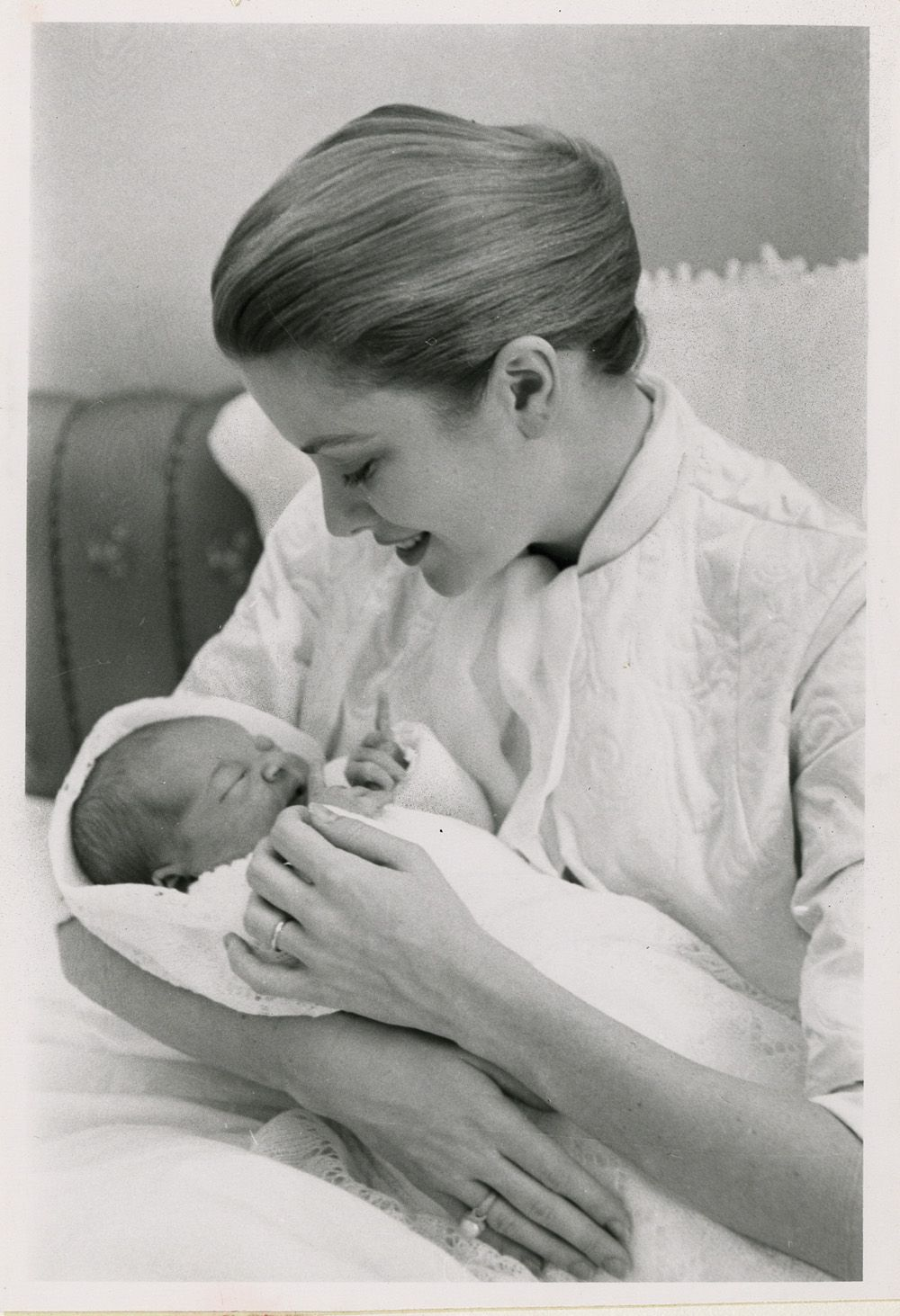 Grace Kelly with princess Caroline as newborn and with