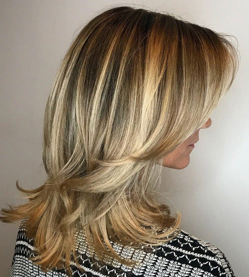 Medium Blonde Hairstyle with Flicked Ends