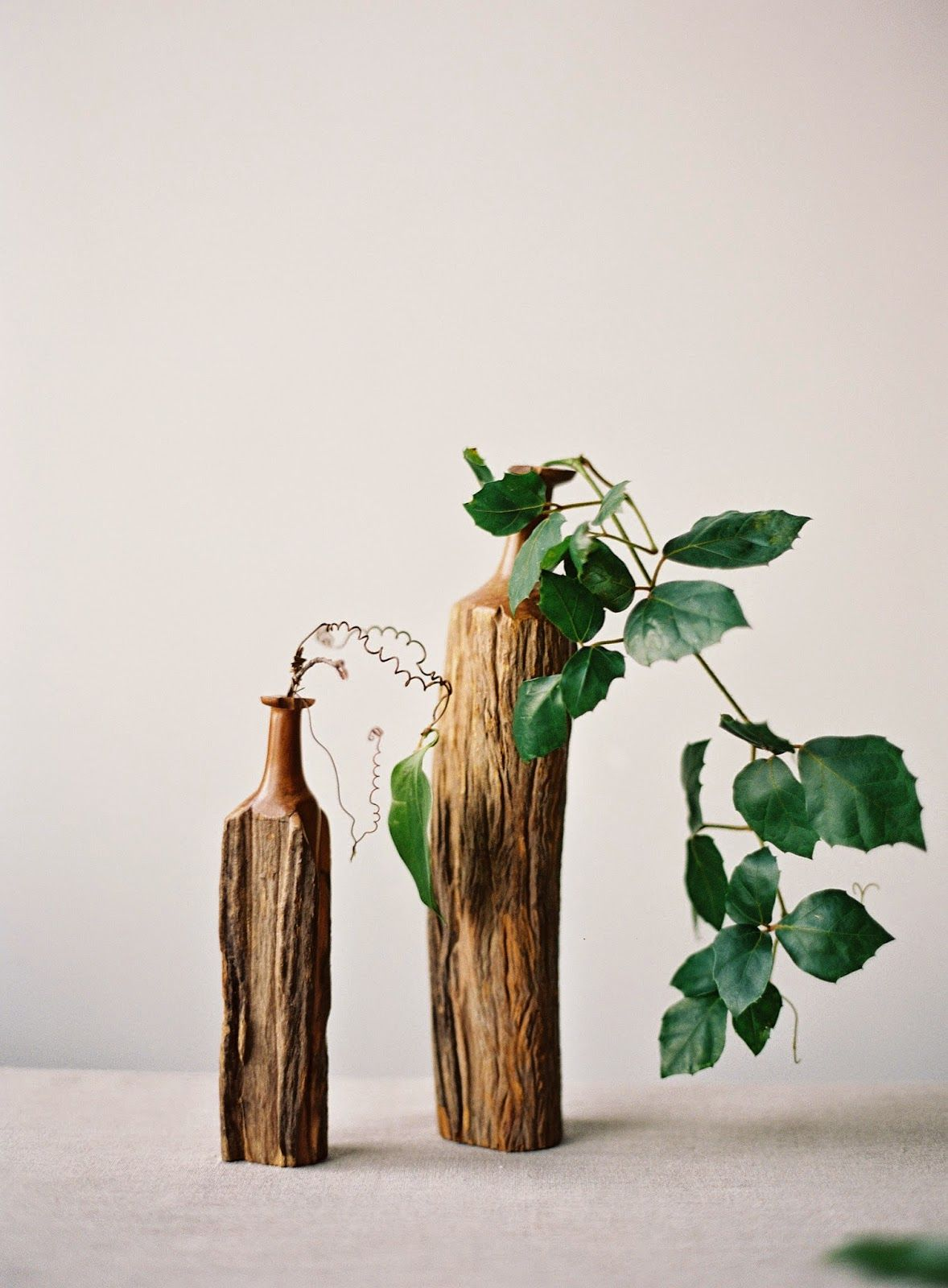 Natural vine in vases by Sarah Winward, Honey of a Thousand Flowers. Photo by Rylee Hitchner