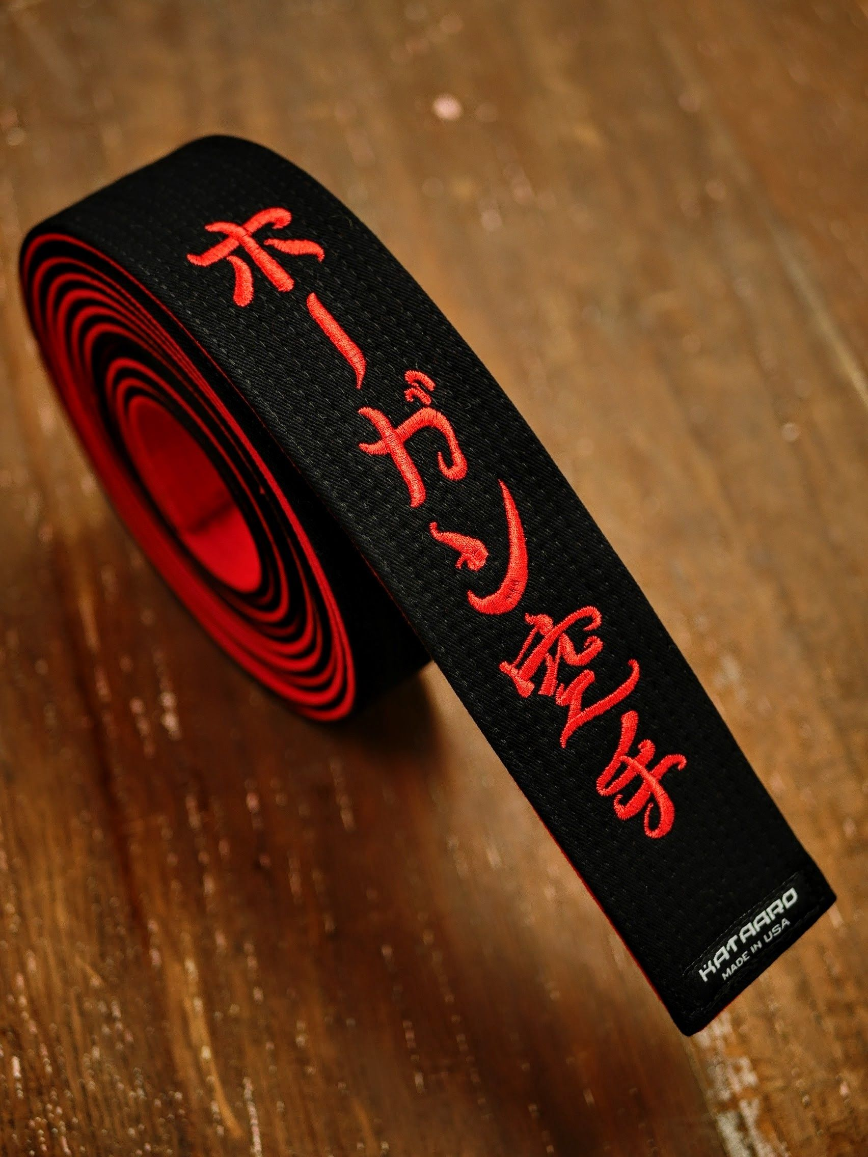 Black Red Master Belt, Black on the front surface, Red on