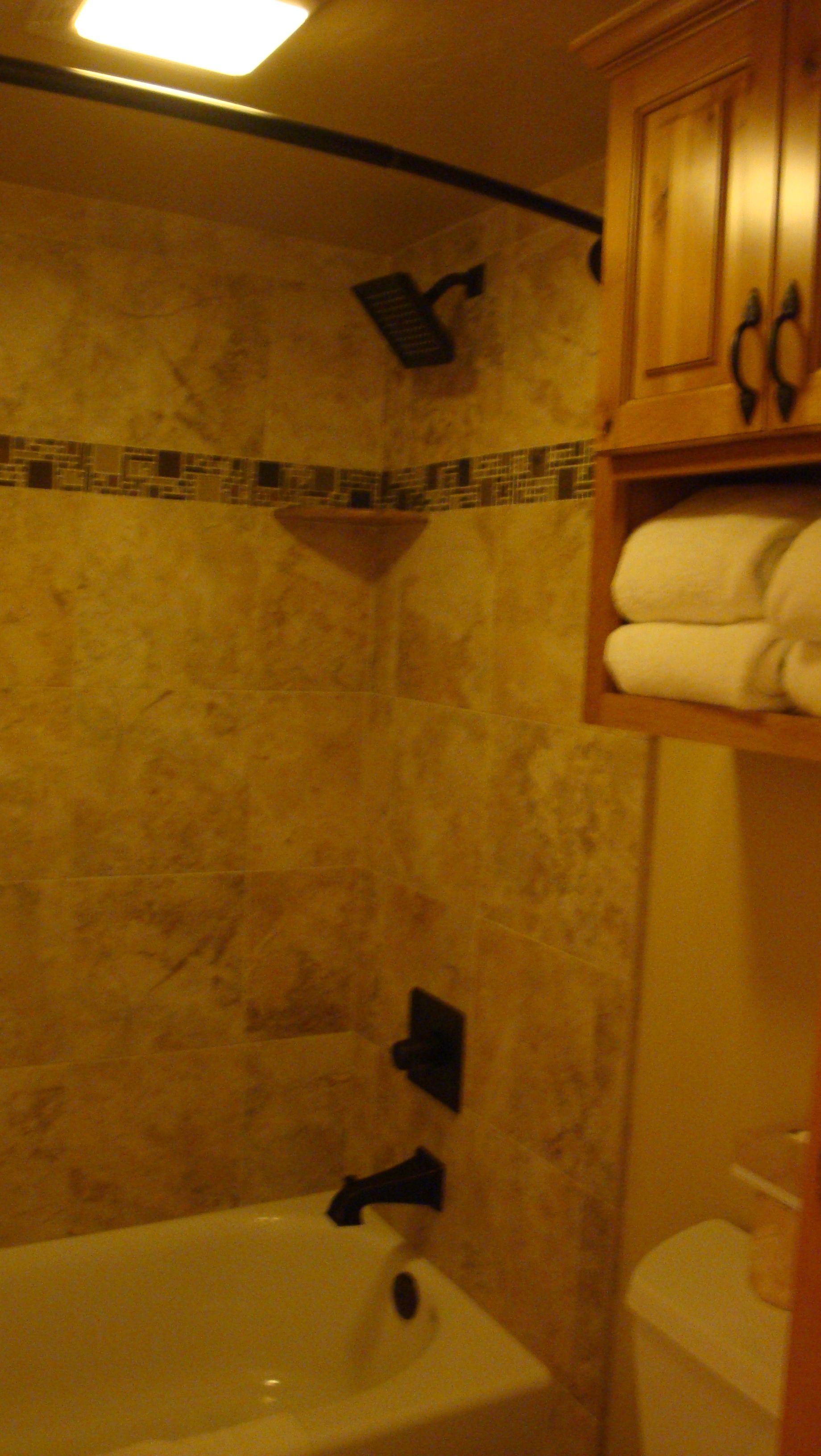 Lakeland Village 470 kids bath tub. 12x12 tile with slate and glass ...
