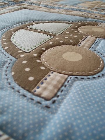 the hand quilting around objects in quilt, not just lines