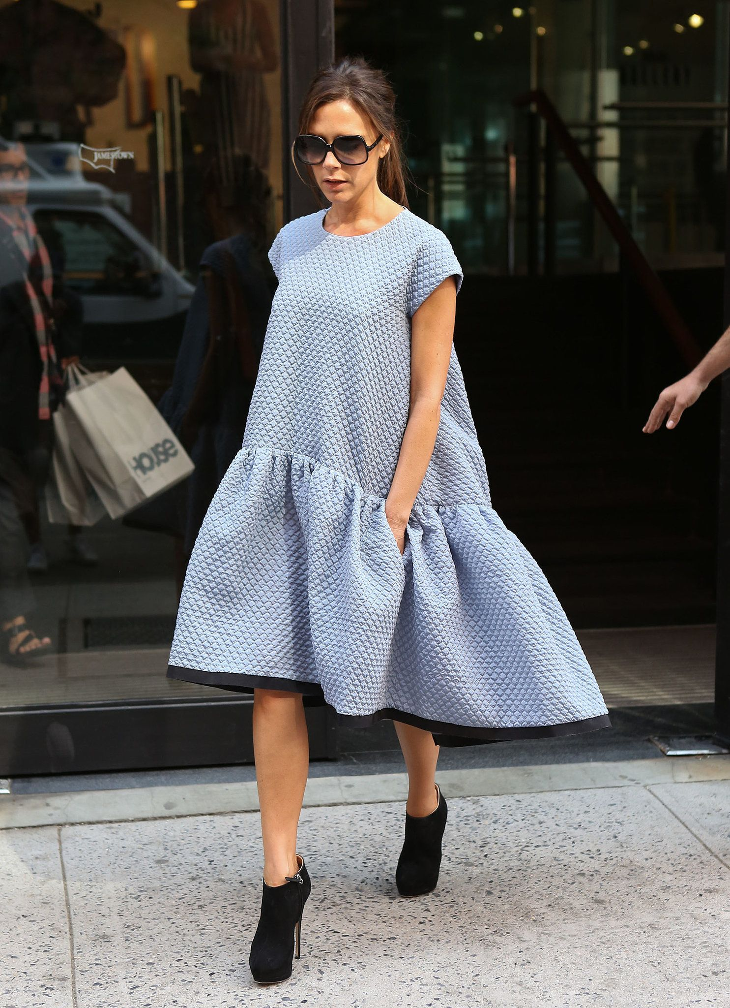 VB swapped her usually streamlined styles for a voluminous drop-waist Victoria Beckham dress while out and about in NYC.