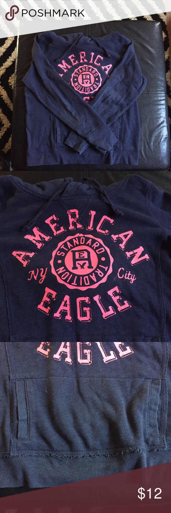 American Eagle Navy Blue Logo Hoodie Navy Blue Hoodie with Pink Logo Writing from American Eagle! This is a size Large (L)! American Eagle Outfitters Tops Sweatshirts & Hoodies